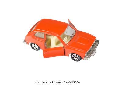 Orange toy car isolated on a white background
