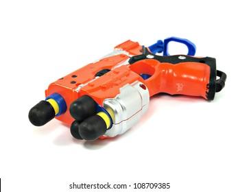 orange toy dart gun on a white background