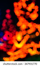 Orange tree lights blurred