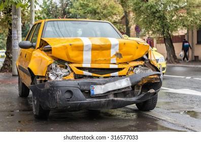 Orange vehicle wrecked in horrific car crash, dragged on sidewalk