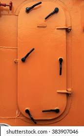 Orange and very strong iron door on deck of ship