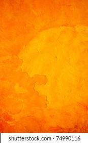 Orange wall with cracks and peeling paint.