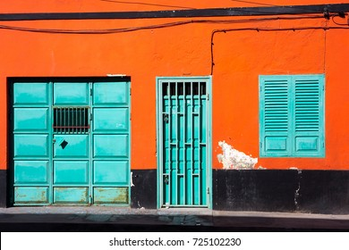Orange wall, cyan windows and door. Colorful Cape Verde architecture