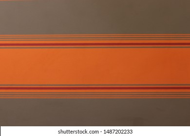 Orange wall with grey and red highlights.