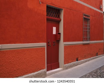 Orange wall and red door.