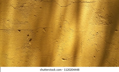 Orange wall with texture and backgrounds spoiled with sun shadows.