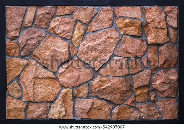 orange wall of a wild stone close up