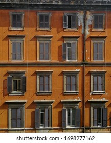 Orange wall with windows in the Rome of Italy