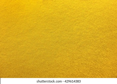 Orange wallpaper with curved lines texture.