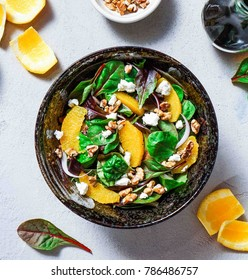 Orange, Walnut and Goat Cheese Salad. Healthy Eating Concept. Toning.