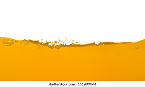 Orange water surface with bubble and water splash on white background