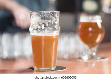 Orange wheat beer isolated on bar surface. Candid bar image concept.