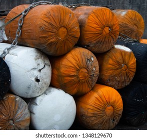 Orange, White and Black Bundles Held with a Chain