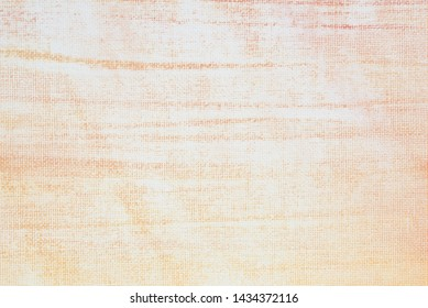 orange and white painted on artistic canvas background texture closeup