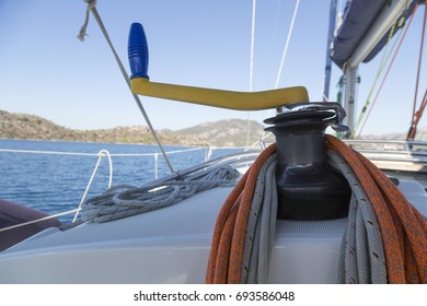 Orange and white rope on the boat