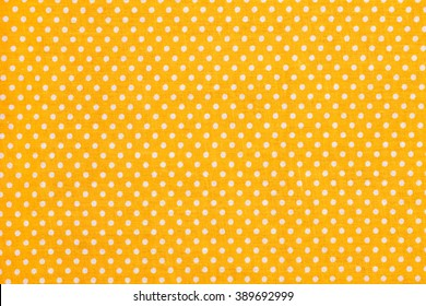 Orange and white tablecloth picnic texture. Textile, napkin, tablecloth. View from above, top. Traditional pattern and color.
