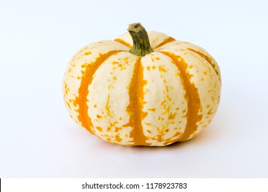 Orange and white tiger striped pumpkin on a white background