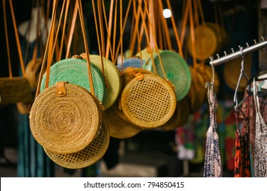 orange wicker bag with leather clasp is sold in the market in the tourist area in Asia. Souvenirs of Bali at the Ubud Market