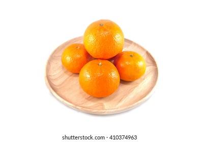 orange in a wood dish