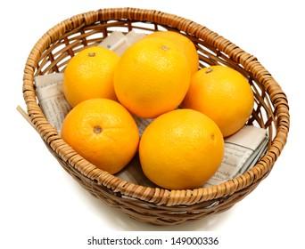 Orange in wooden basket