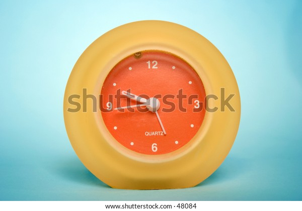 An orange and yellow clock.