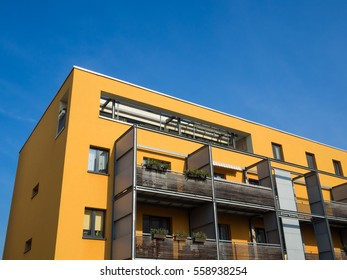 orange or yellow facade color apartment house