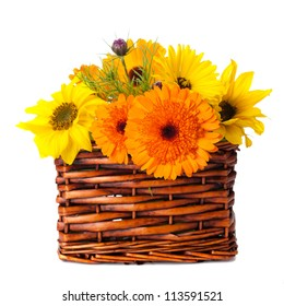 Orange and yellow flowers in a basket on a white background