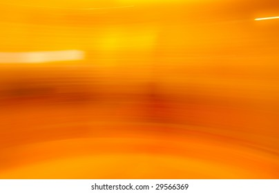 Orange and yellow golden abstract motion blur background.