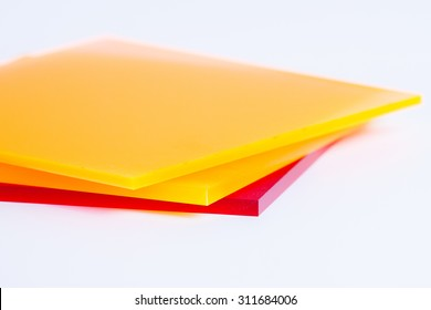 Orange yellow and red plexi glass sheets on the white background