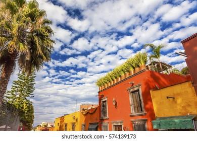 Orange Yellow Town Street Tourists Hotels San Miguel de Allende Mexico.