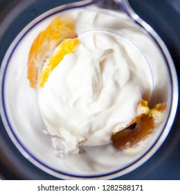 Orange with yoghurt in cup