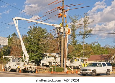 Orangeburg SC/USA-November 29,2017: Linemen in bucket trucks replacing high tension wires and pole in preparation of inclimate weather