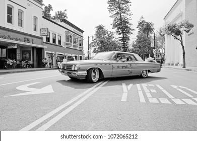 ORANGE/CALIFORNIA - APRIL 15, 2108: Classic 1962 Buick departing a gathering of classic car enthusiasts. Orange, California USA