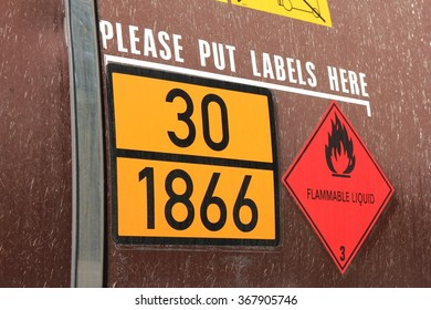 orange-colored plate with hazard-identification number 30 and UN-Number 1866 (resin solution, flammable