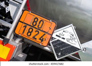 orange-colored plate with hazard-identification number 80 and UN-Number 1824 (sodium hydroxide solution)