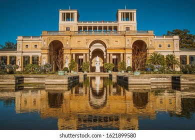 The Orangery Palace with reflection in water in the Sanssouci Park - Potsdam, Germany