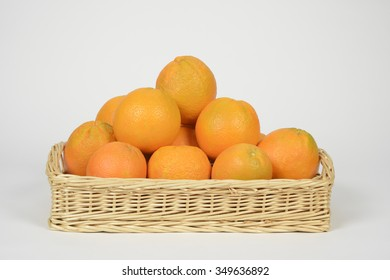 Oranges in a basket on white background