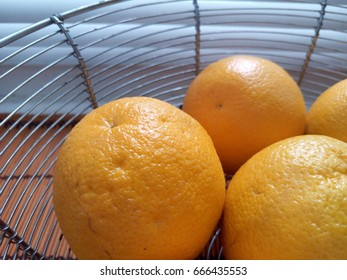 Oranges. In the basket. On the window.