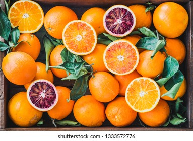 Oranges citrus fruits background.Red and white oranges.