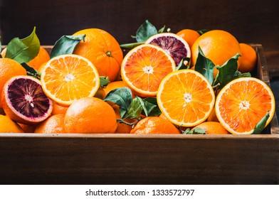 Oranges citrus fruits in box.Red and white oranges.