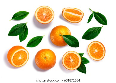 Oranges (Citrus sinensis fruits), whole, split, quartered, with leaves. Clipping paths for each object, shadows separated, top view