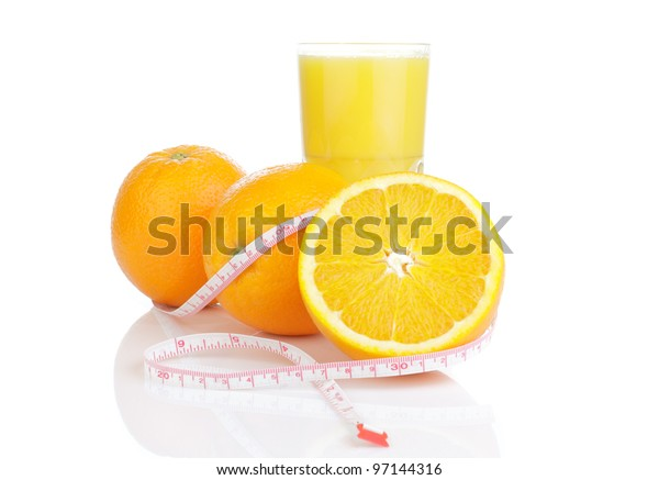 Oranges and fresh orange juice. White background. Isolated.
