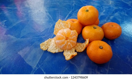 The Oranges fruit and blue floor background