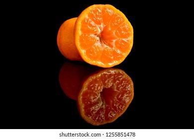 oranges fruit on black background.with reflection