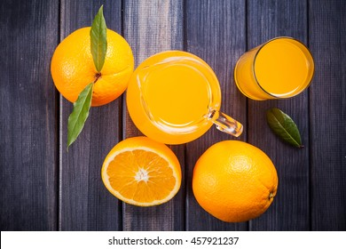 oranges and juice in the jug wooden table rustic still life top view