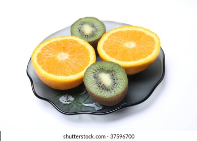 oranges and kiwi on a plate