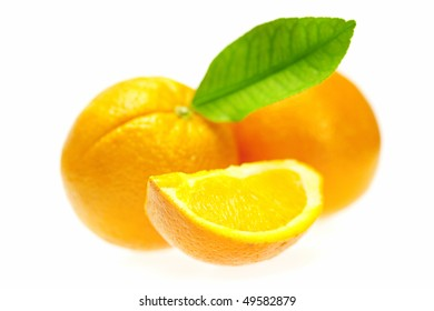 oranges with leaves isolated on white