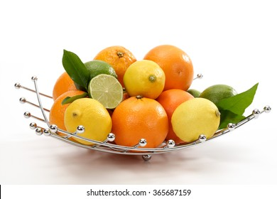 Oranges, lemons and limes in bowl