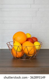 Oranges, lemons and tomatoes on kitchen counter