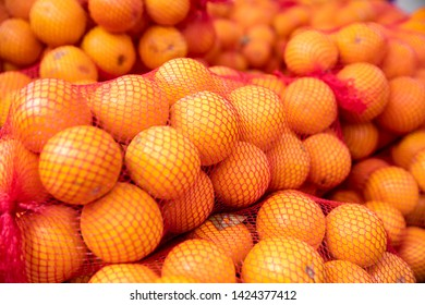 Oranges in the nets on the market. This is the future orange juice.